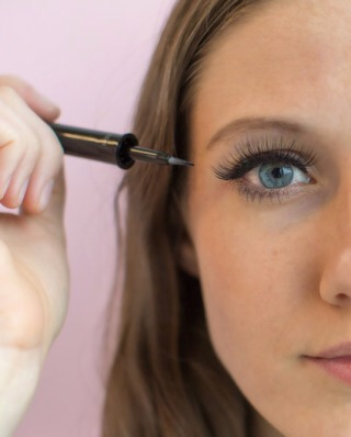 Apply a line of liquid mascara to hide the line of the falsies