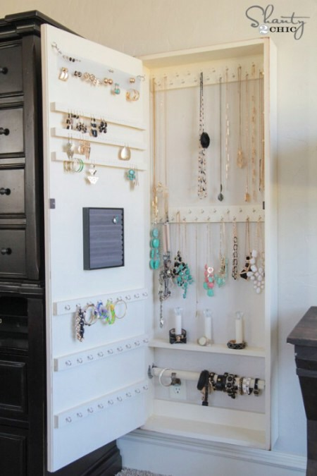 Hideaway Jewelry Storage It's a hideaway jewelry cabinet that has a mirrored door and it fits perfectly wherever you have room on the wall. It's got hooks for everything and will seriously hold tons and tons of jewelry and keep it perfectly organized.