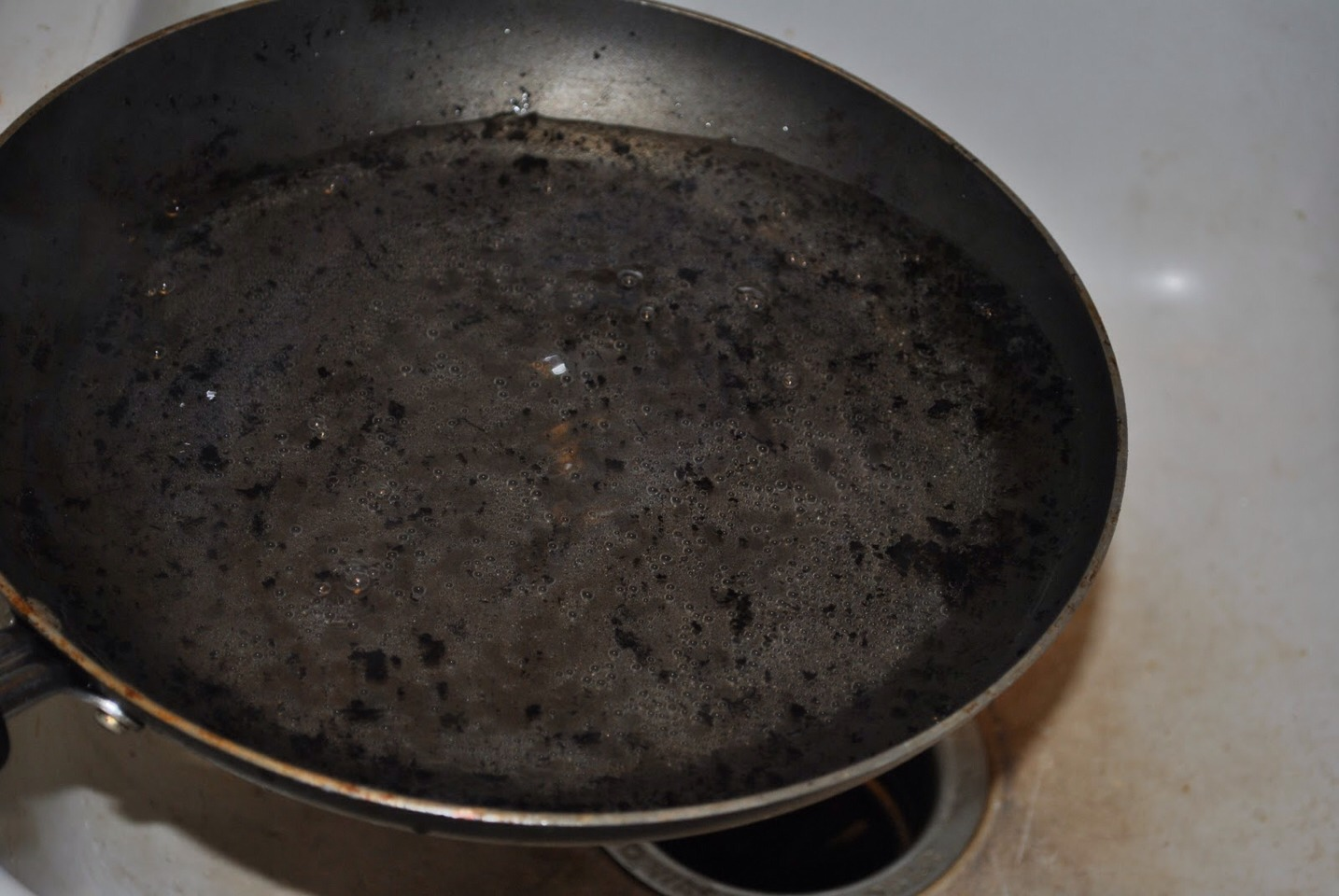 Simply boil some coca-cola in your burnt pan and whala! Very easy!