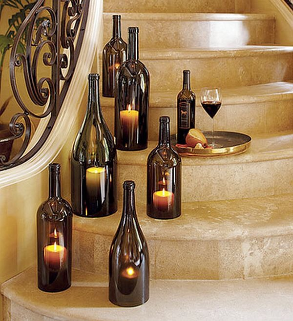 3. Wine Bottle Display: Take old wine bottles and remove the bottom, then set a lit candle inside (make sure the cap is off).