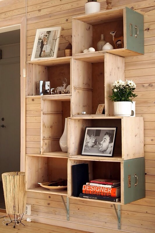 Old cabinets and crates into a bookshelf .