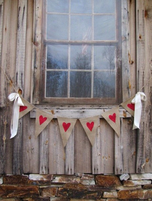 Get burlap and cut out triangular pieces. Glue red felt hearts into the burlap, or draw red hearts into it with sharpie. Tue with a string and drape it along a windowsill or desired area.