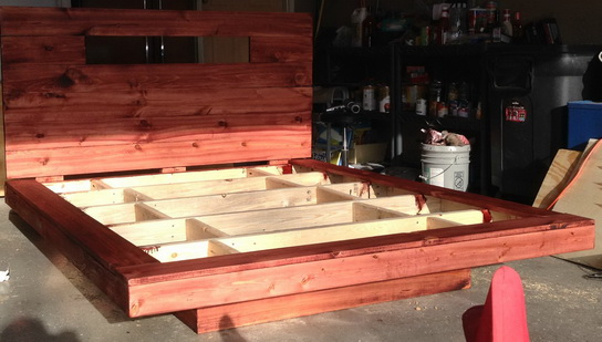 The bed frame and headboard were stained with a cherry colored wood stain and given time to dry.