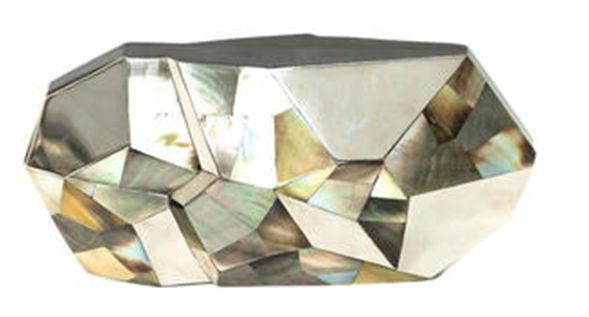 The artistic or avant garde bride will love this faceted shell clutch by Susanna Valero from Bottica that looks like a work of art. This would be the perfect accompaniment to a wedding held in an art gallery or at chic city wedding venue.
