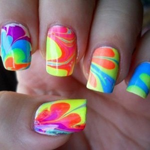 Water marble nails Paint your nails white Using room temperature water in a small cup. Use any polishes you want and drop the polish in the center of the water. Use a toothpick to swirl a design and then dip your nails at a angle into the water.