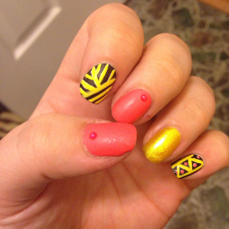 Pink & yellow nails with abstract accent nails