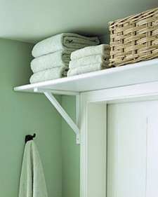 Towel Shelf Above Bathroom Door  Tight on space? Use that unused space above the bathroom door to store extra towels, washcloths, and more.