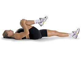 LYING CHEST STRETCH: Lie on your back with your knees bent at about 90 degrees and your feet flat on the floor. Bend your arms at 90 degrees, and place them on the floor beside you, with your forearms parallel to your head and your palms facing up.