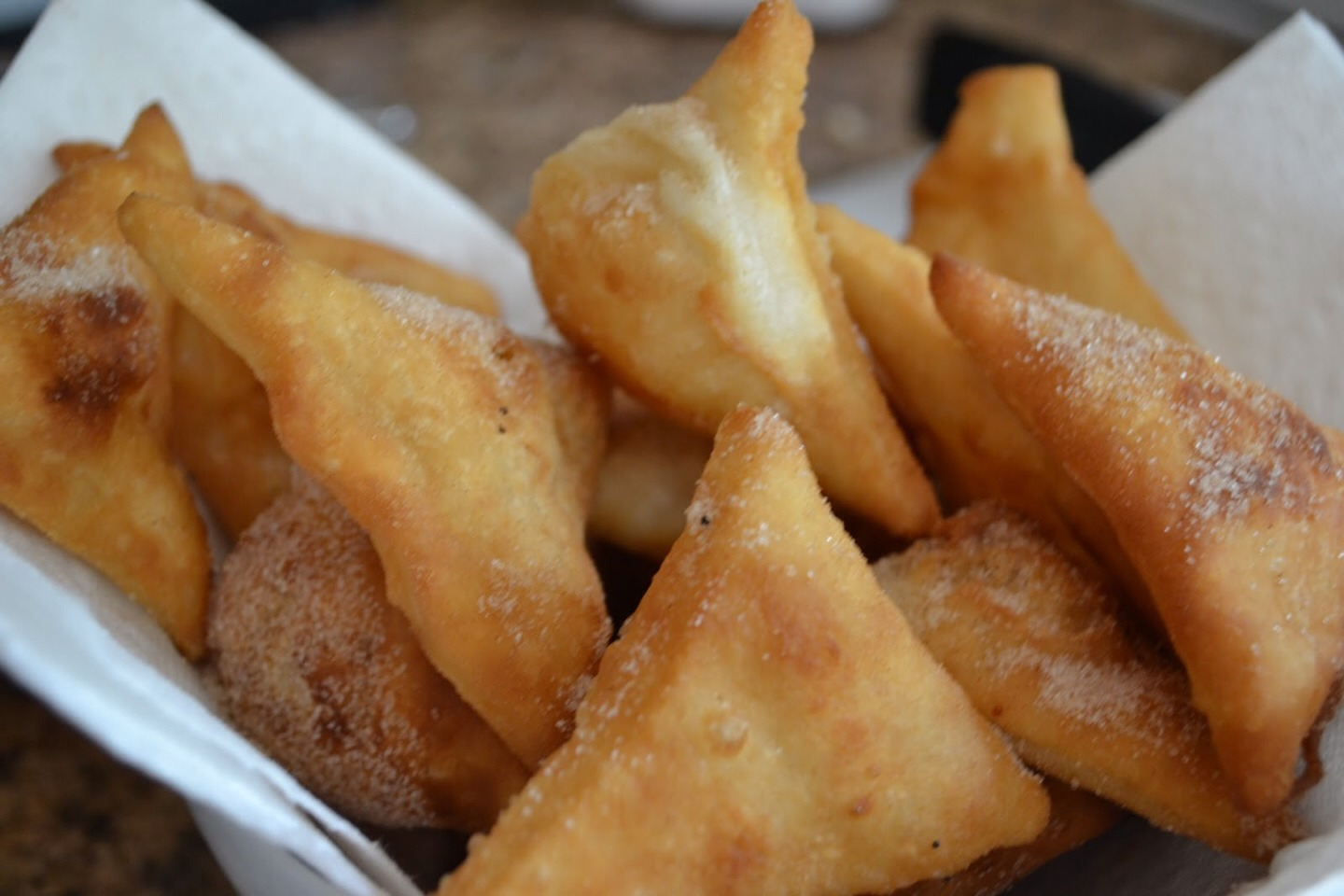 The dough should just about double in size. Punch down and roll out on a lightly floured surface so that it's about 1/4 inch thick. Cut into triangles, squares or other fun shapes. In a large, heavy pot heat enough oilso the Sopapillas can float to around 375°F. Fry the Sopapillas until browned
