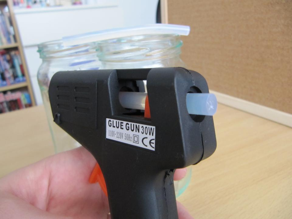 Push the glue stick into the back of the glue gun. Plug it in to a socket and wait a few minutes so the glue has a chance to melt.