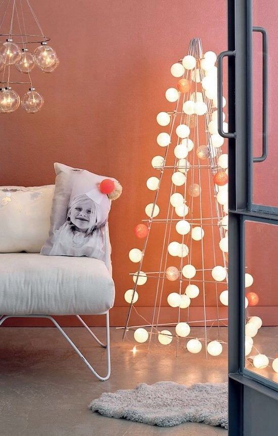Wire Frame and Globe Lights  Spare and modern, this tree alternative tucks into any corner.
