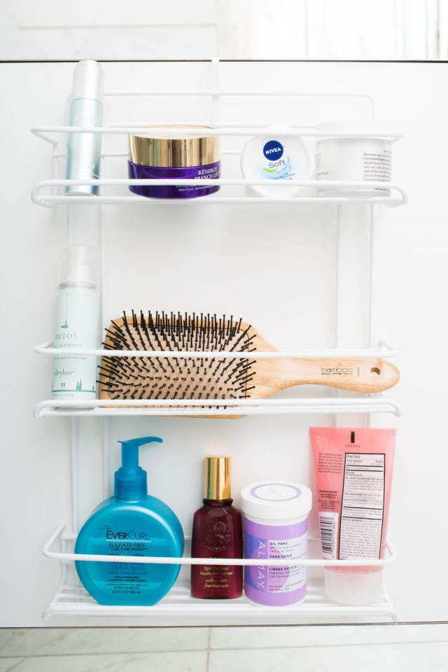 8. Create additional bathroom shelving by hanging a spice rack on the inside of your cabinets. This is great for the woman who owns more moisturizers and serums than spices.