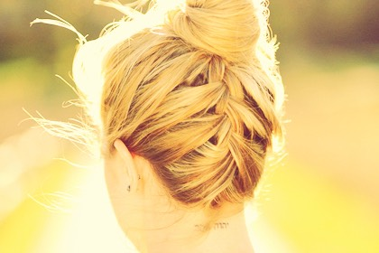 Back braided high bun.  Although this hairstyle looks great! Unfortunately it is quite a tricky one when you are not used to it. It keeps everything off your face, back and will keep you cool and stylish in the summer.