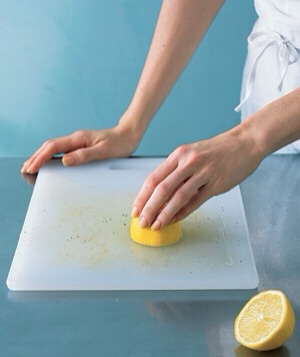 To remove tough food stains from light wood and plastic cutting boards, slice a lemon in half, squeeze onto the soiled surface, rub, and let sit for 20 minutes before rinsing. The best part? You'll have a house that smells like a lemon grove rather than chemicals.