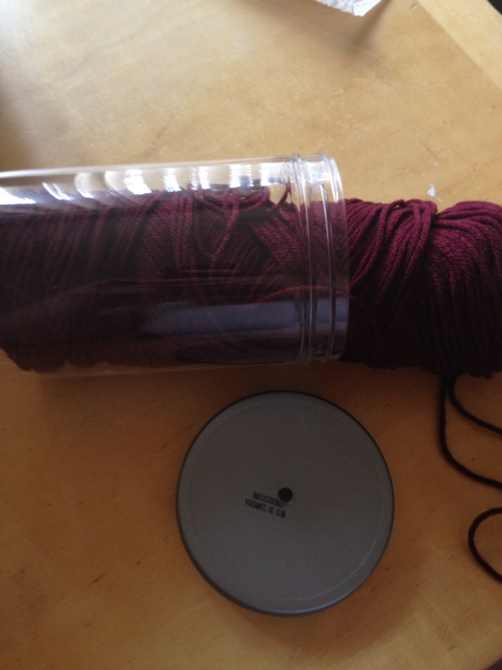 Insert your yarn inside the container