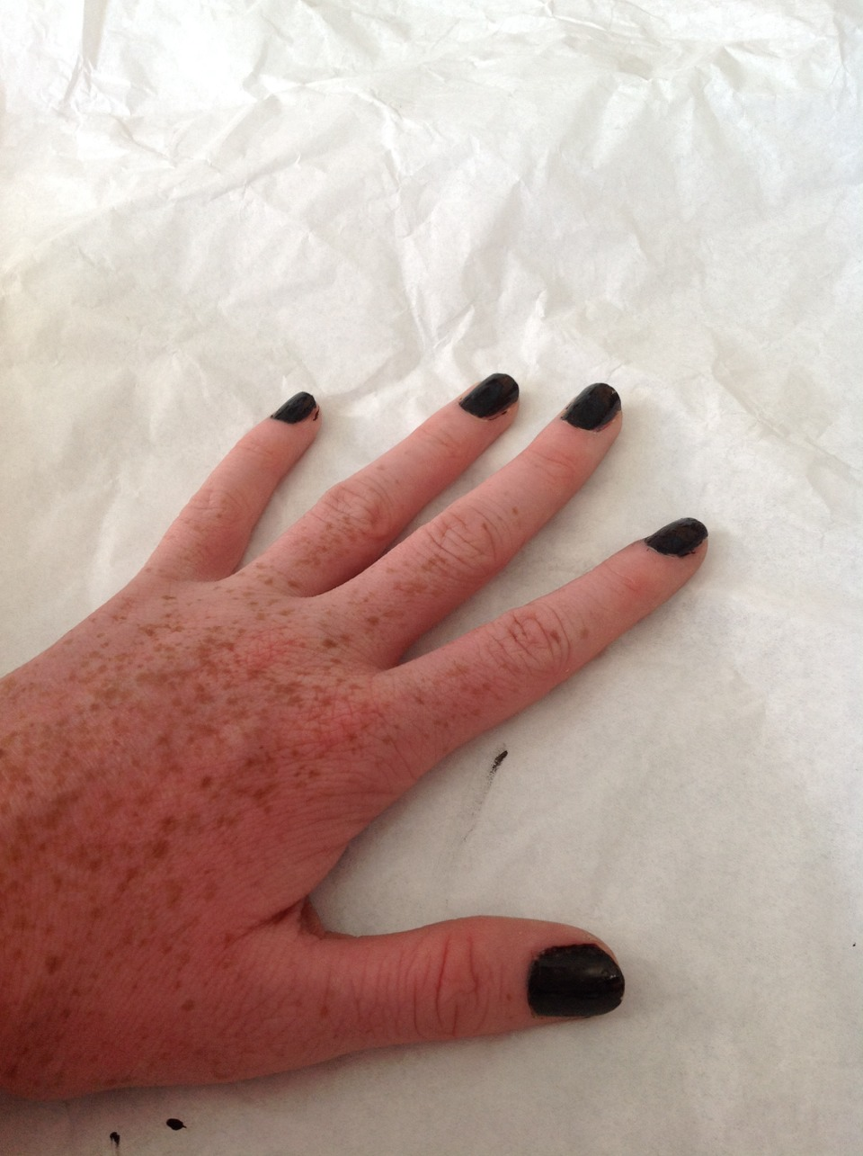 Begin by painting your nails black