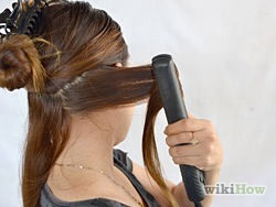 Fold the hair backward. Once the hair is in your iron, just fold it backward, away from your face, and hold the position for a few seconds.