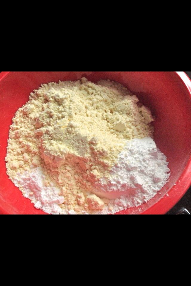 1 cup of yellow cake mix + 1 cup of confectioners sugar in microwave safe bowl