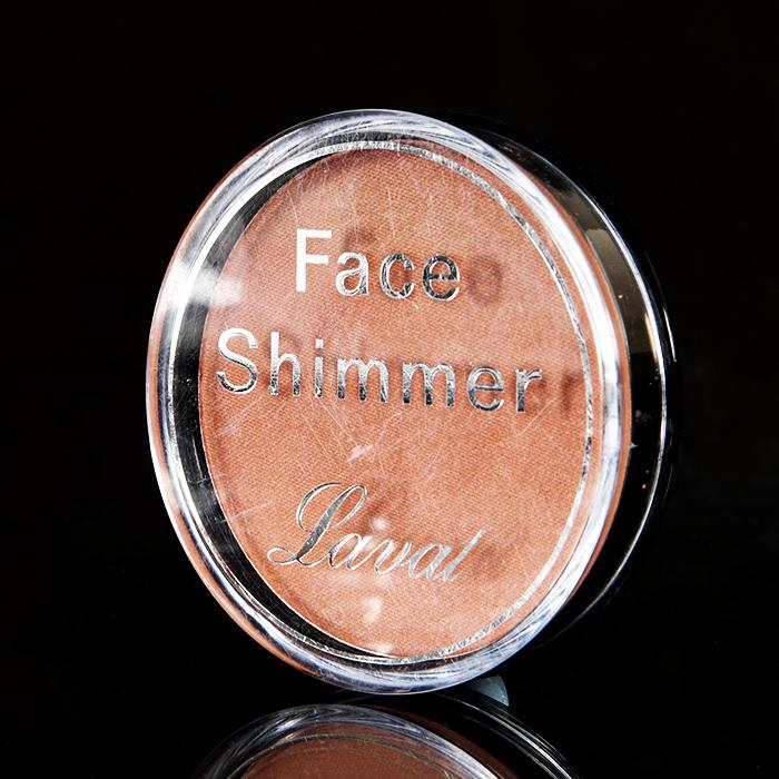 Avoid using blush. This kind of defeats the purpose of covering your rosy cheeks. Instead, opt for a face shimmer. Lightly dust  onto the apples of your cheeks for an instant glow! Any drugstore face shimmer will do!