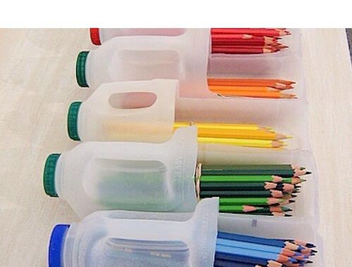 Grab a craft knife and recycle your large plastic milk bottles in to pencil holders. Extra points if you go all OCD and file them by colour