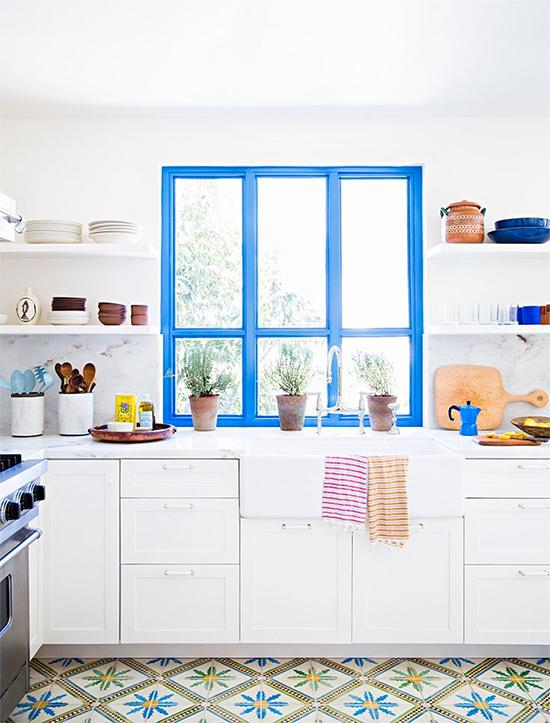 this beautiful kitchen with a bright blue accent window. I love the idea of simply painting the frame of a window. And this is such a great example! The blue really pops in the mostly white kitchen. Now I just have to decide what color to use