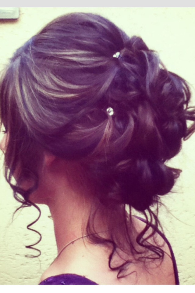 A beautiful updo pinned loosely with jeweled clips!