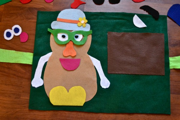 """Unlike a Real Mr. Potato Head, these pieces can be stored easily and also be a great toy to bring while traveling.  I obtained this idea of a Felt Mr. Potato head while browsing through """" Busy Books"""" online."""