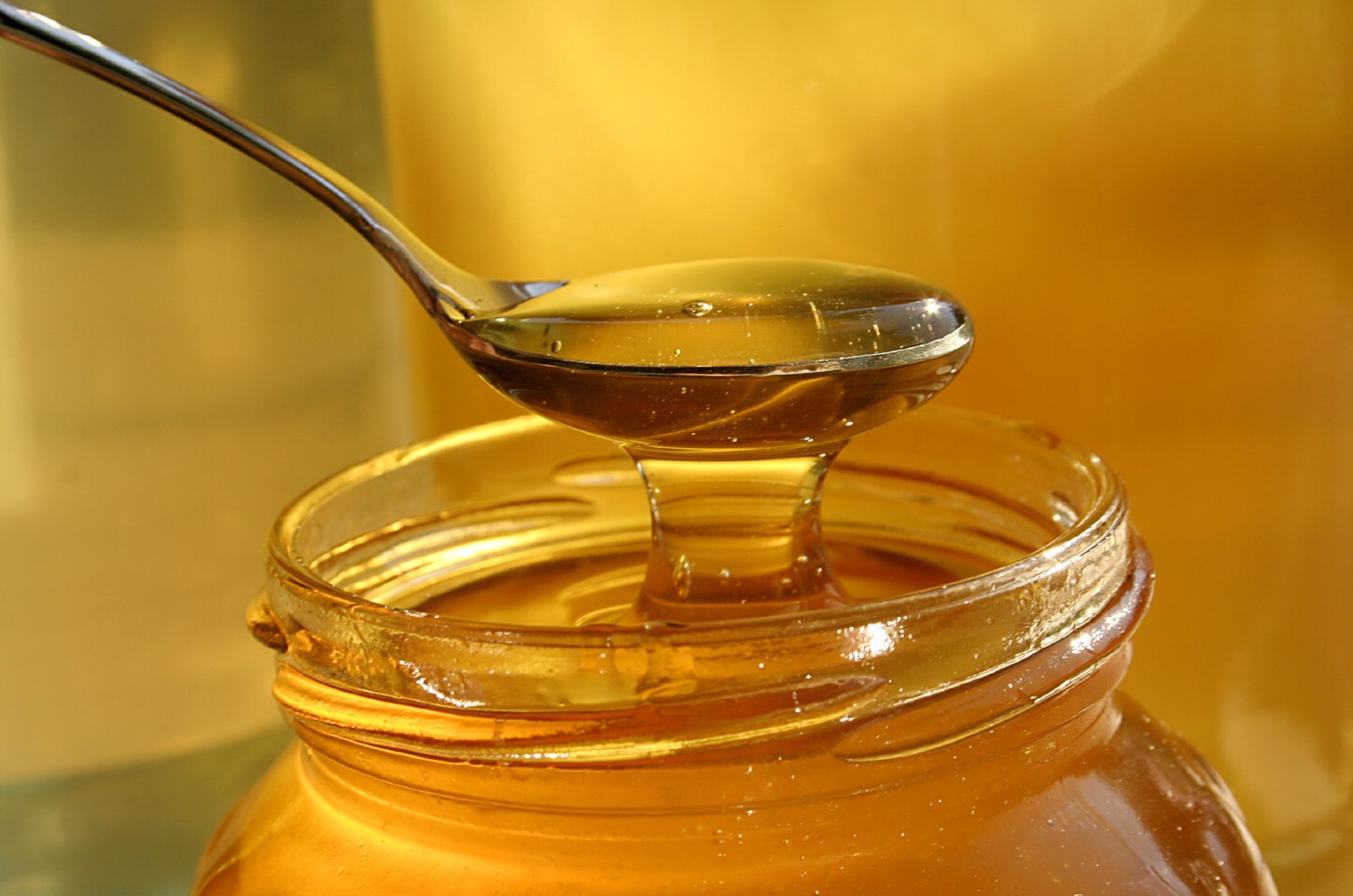 Next, take 1 teaspoon of honey and mix it with the milk in the small bowl
