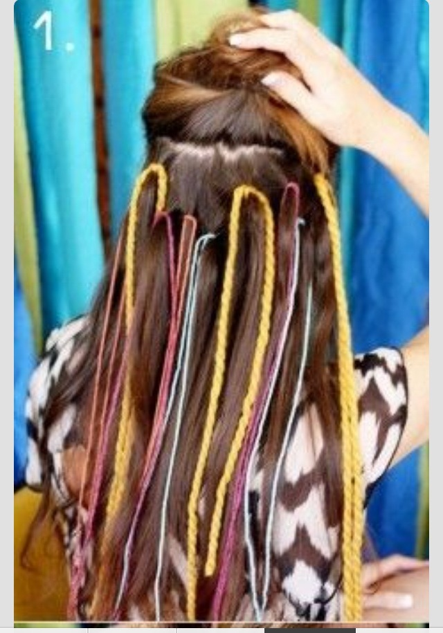 You will need yarn or sting. Lift up hair around your crown. Tie yarn or string.