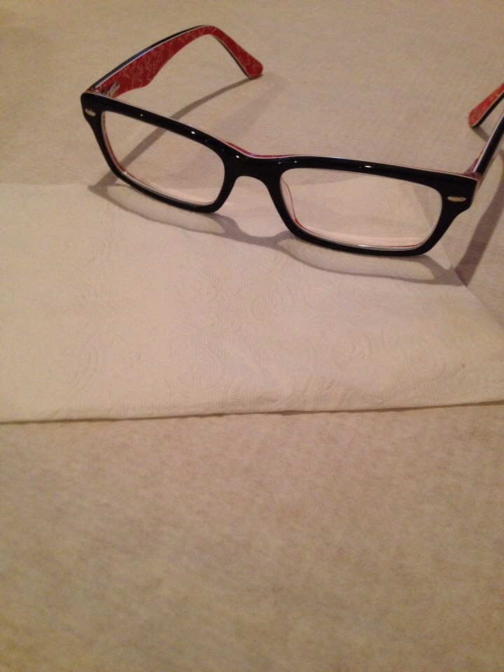 Never clean your glasses with tissue the wood particles in the tissue will scratch your glasses!