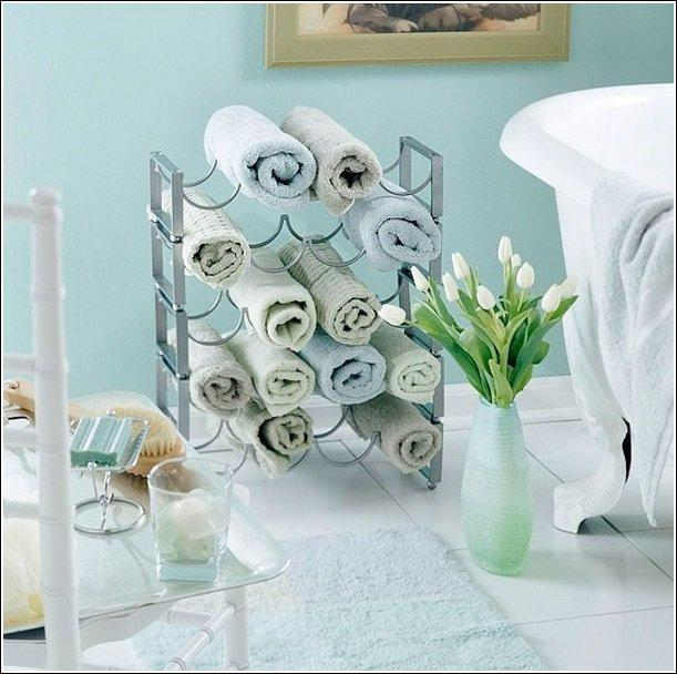 A wine rack makes a perfect towel organizer.