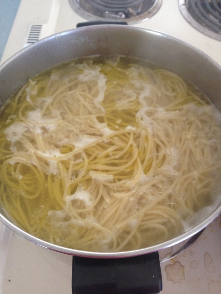 While the meat is browning, put some water to boil & add a large packet of whole grain wheat spaghetti noodles