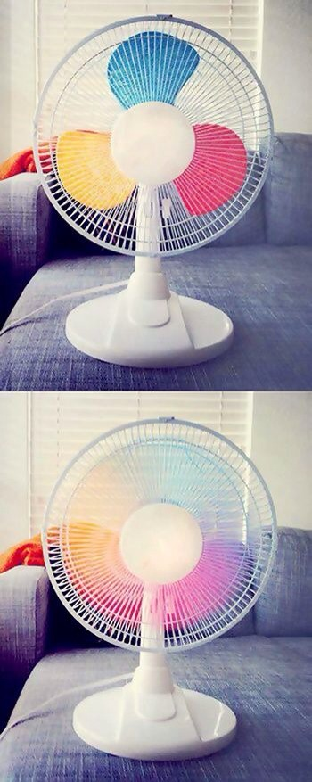 Paint primary colors on a fan to get a rainbow fan!