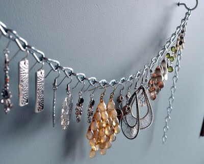 On a Chain  A chain makes for a clean and simple way to hang your jewelry.  Check it out at Cleverly Inspired.  http://cleverlyinspired.blogspot.com/2011/09/dangling-earring-organizerfor-2.html?utm_source=feedburner&utm_medium=feed&utm_campaign=Feed%3A+Cleverlyinspired+%28cleverlyinspired%29