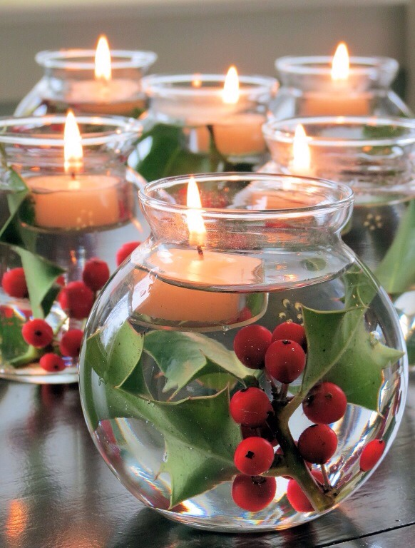 Add holly to little vases, fill with water and finish with tea light candles.