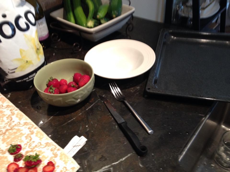 you need: plain vanilla yogurt, strawberries, bowl, fork, tray, and freezer (to freeze).