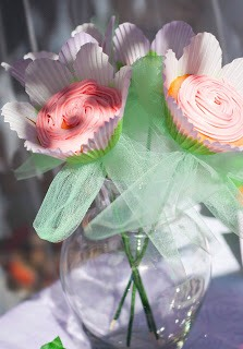 You can buy flower cupcake wrappers and make a bouquet of cupcake flowers