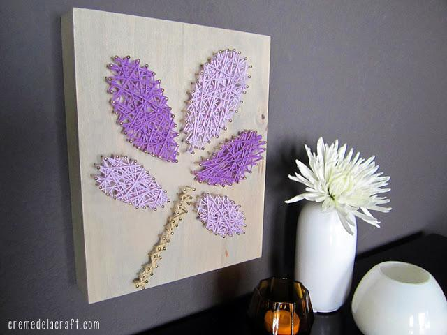 Materials: • Yarn (I used Lion Brand Yarn Bonbons in 3 colors: purple, palest lavender and tan) • Piece of wood at least 1/2 inch thick • Printout of your desired pattern • Box of nails • Hammer • Scissors • Tape