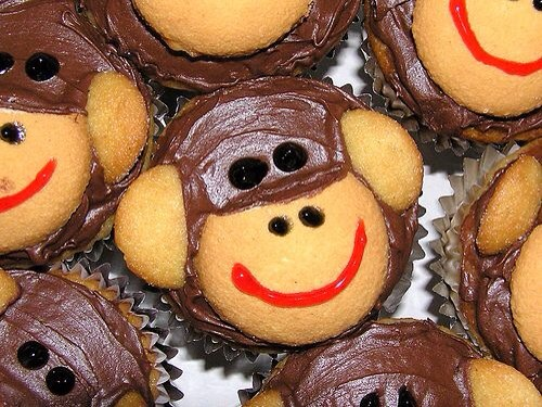 Nilla Wafers as the ears and muzzle, then frosting for eyes, nose, and mouth. If you save, like it too:)