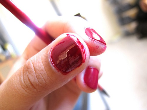 If you get nail polish on your skin, the best thing to do is leave it and let it dry. If you try to clean it off, you risk damaging your freshly painted nails.