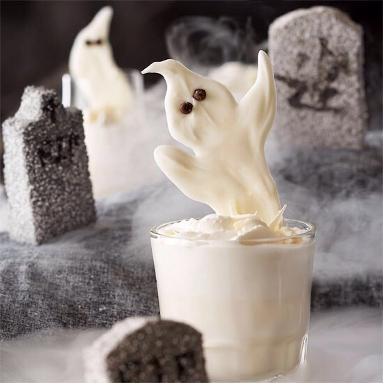 Ghostly Spirit The spirited adults-only potion is shaken with ice to blend the vodka, white chocolate liqueur, milk, and whipping cream. Topped with a spritz of whipped cream and the ghostly garnish, the taste will haunt your party guests' dreams