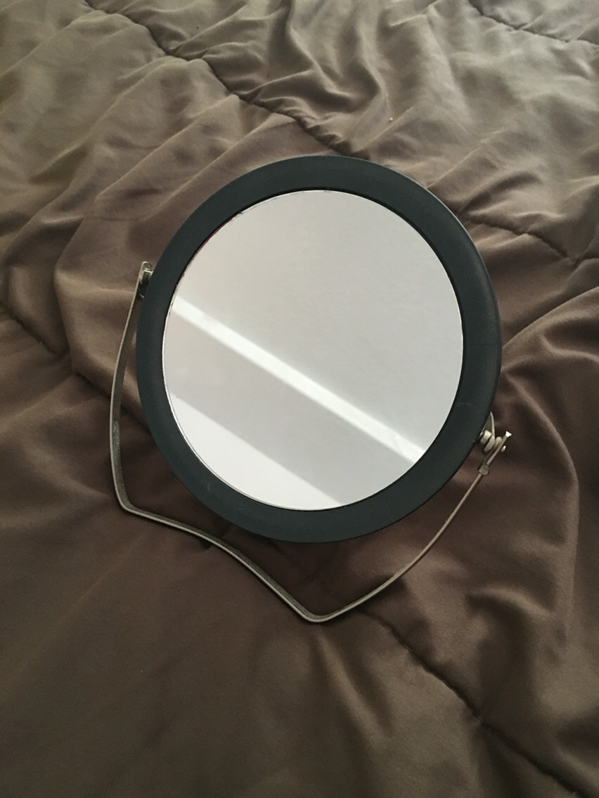 This is my 5x mirror. I pluck my own eyebrows so this really comes in handy.  I bought this one at Burlington for $2.99.