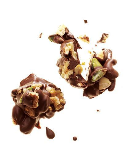 Dark Chocolate and Nut Clusters  Mix ¼ cup unsalted roasted nuts and 1 ounce melted dark chocolate (70 to 80 percent cocoa). Drop onto wax paper; refrigerate until set.  195 Calories   3g Fiber   4g Protein   14g Fat  