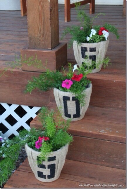 Burlap House Number Planters  I'm always on the lookout for cute house number ideas, and this is great. Hopefully you don't have more numbers than steps!