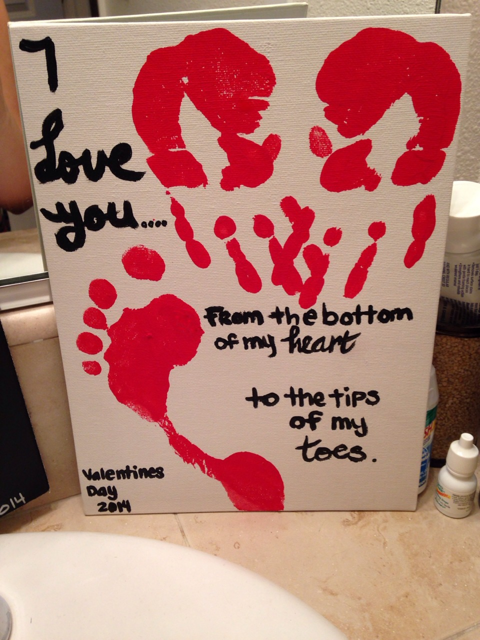 Need: paint, canvas, paint brush, feet and hands and maybe some extra help! Make sure your hand prints make a heart. Something simple and different and they can keep it forever.