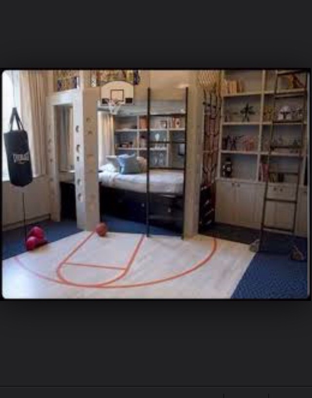 I think this bedroom is really cool. Especially because it has a basketball hoop right in the room!🏀🏀🏀🏀🏀also because you can go on top of your bed!🏀