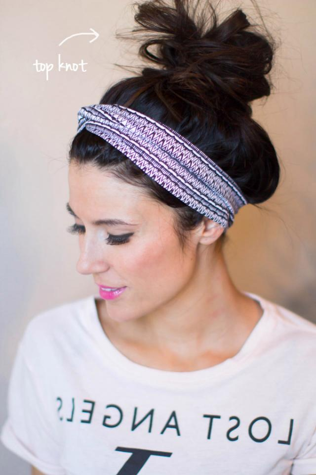 For a super-easy quick fix, place a pretty and thick elastic headband right near the hairline and tuck your bangs underneath. Finish it off by pulling your hair back into a messy-on-purpose bun. Pin back any stray pieces of hair as needed.