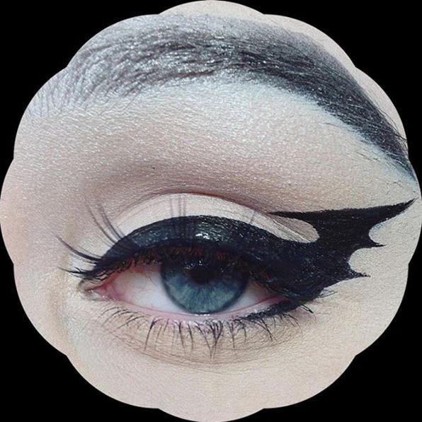 The hero we all deserve: Batman eyeliner.