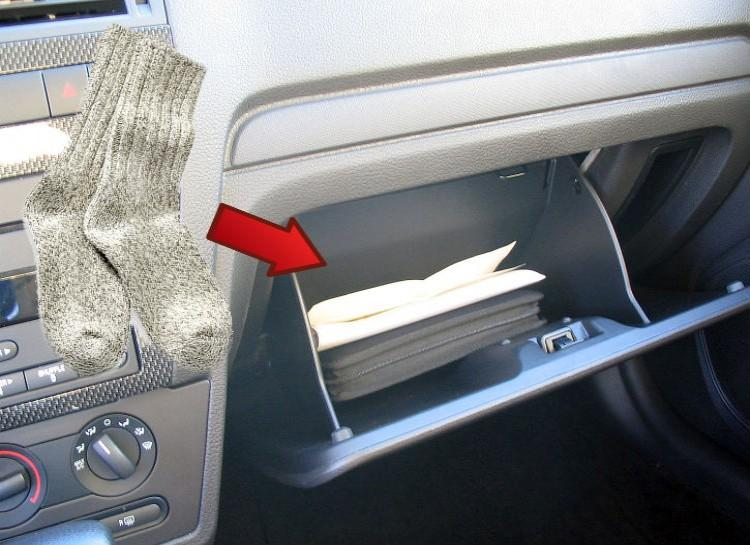 The Sock Box Keep a pair of socks in your glove box. No, this isn't because your mother will worry about you having cold feet. It turns out that putting on some nice wool socks over your shoes will help give you much better traction in case you have to push your car over ice, or snow