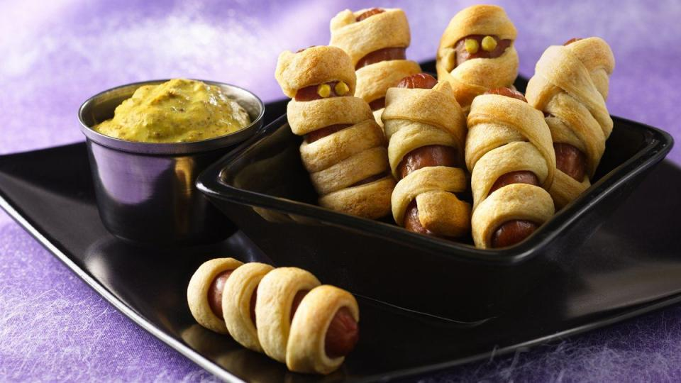 Wrap up snacks with these smoked mini-sausage treats, wound up in strips of refrigerated flaky dough.
